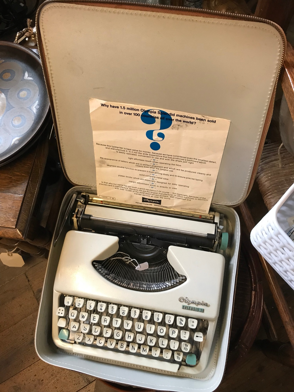 Vintage typewriter in travel case at an antiques shop
